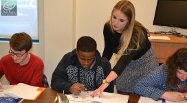 UCO student Elyse assists a DRTC Employment Services Program participant during an activity.